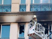 نجات جان ۱۴۰نفر از ساختمان آتش گرفته در شهرک غرب +عکس
