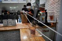 ابتکار یک کافه در شهر بانکوک تایلند برای ردو بدل کردن اسکناس +عکس