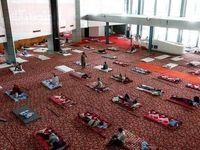 تبدیل یک ورزشگاه به پناهگاه برای کارگران مهاجر در دهلی نو +عکس