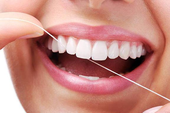 چرا باید از نخ دندان استفاده کرد؟