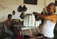 سلاخی مارها برای ساخت کیف و کفش! +تصاویر