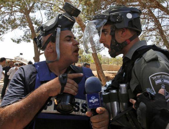 درگیری خبرنگار صدا و سیما با سرباز اسرائیلی +عکس