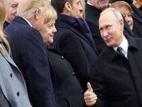 زبان اشاره میان پوتین و ترامپ در پاریس +عکس
