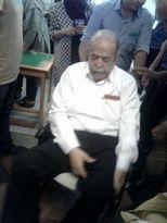 حضور محمدعلی کشاورز در انتخابات با ویلچر +عکس